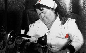 1942 nurse sewing her garter or something