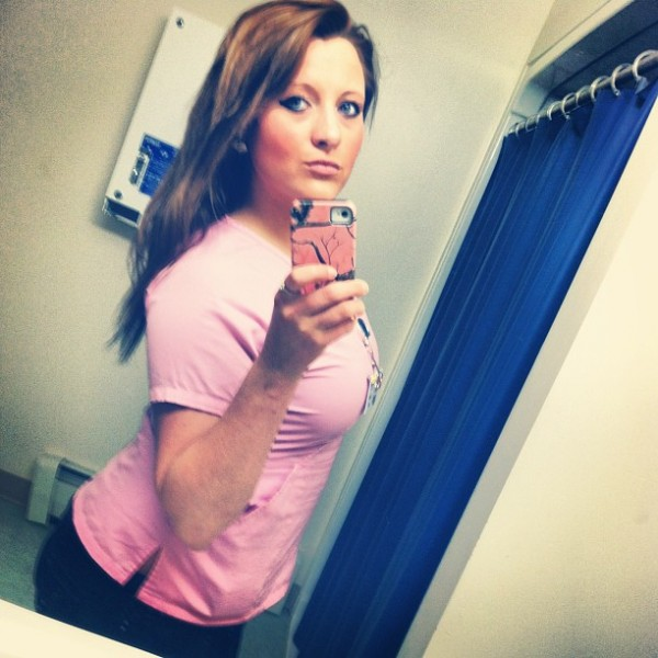 Nurse in pink scrubs selfie