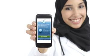 Nurse in hijab with mobile phone