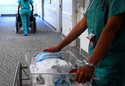 Preparing to transfer a newborn from Labor and Delivery into Couplet Care.