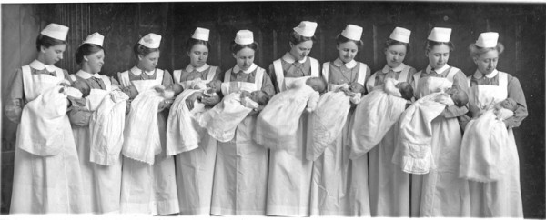The first time there 10 babies in the nursery November 1915 left to right: Clara Schmidt, Lydia Goertz, Anna Gertrude Penner, Elfriede Sprunger, Dora Richert, Anuta Dirks, Marie Lohrentz, Ruth Becker, Elise Fast, Rosa Jantzen used in Lana W. Myers, Newton Medical Center: Merging the Past with the Future (2006), p. 58-59