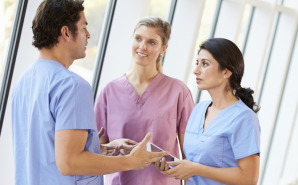 Medical Staff Talking In Hospital Corridor