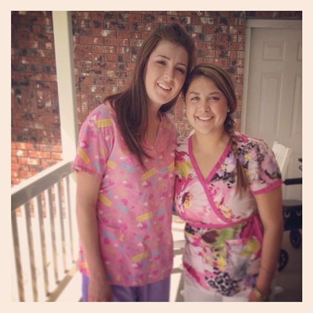 Two nurses in pink scrubs tops