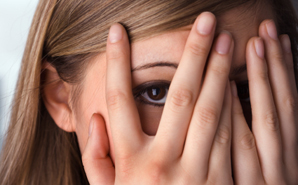teen-hiding-face