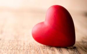 heart sitting on wodden table
